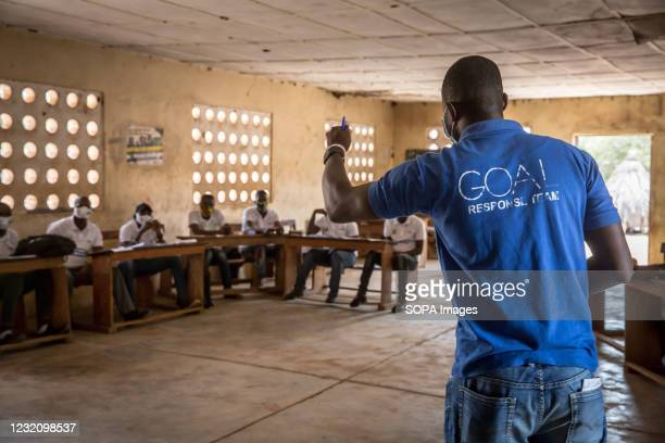 """Facilitator from the charity Goal leads a training for """"community mobilisers"""", who will help their areas create action plans to focus on what to do..."""