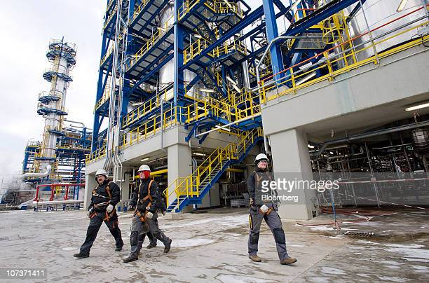 Facility workers leave the mild hydrocracking facility at the Grupa Lotos SA oil refinery in Gdansk Poland on Monday Dec 6 2010 Russian companies...