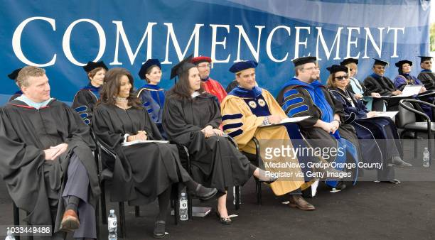 Facilty and staff line the stage during Cal State Fullerton's commencement ceremonies Saturday where Richard Lui, an MSNBC dayside anchor, is the...