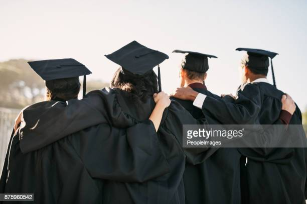 facing a world of new possibilities - graduation clothing stock pictures, royalty-free photos & images