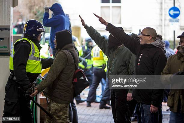 Facist demonstrators show the nazi salute as the clash with Anti Facist demonstrators marching through Dover at a counter demonstration also taking...