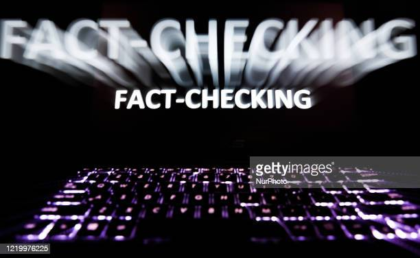 'Fact-checking' sign is seen displayed on a laptop screen in this long exposure illustration photo taken in Poland on June 13, 2020. European...