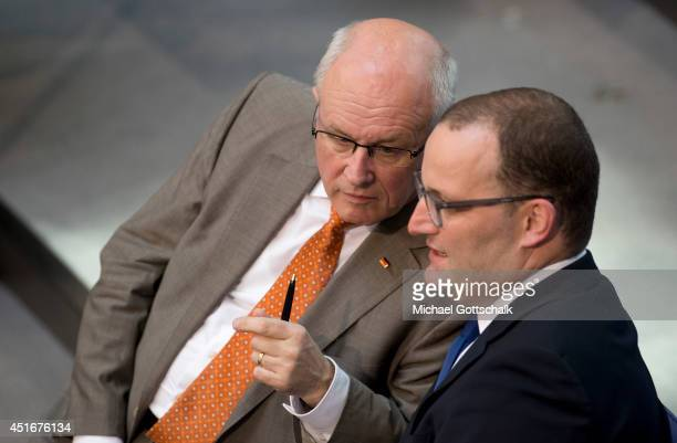 CSU faction leader Volker Kauder and member of parliament Jens Spahn talk to each other during the debate ton federal care insurance reformon July 04...