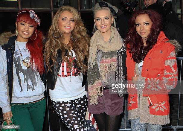 Factor contestants Leigh-Ann Pinnock, Jesy Nelson, Perrie Edwards and Jade Thirlwall of Little Mix are seen leaving BBC Radio 1 on December 5, 2011...