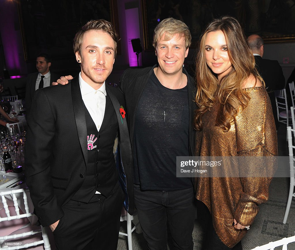 X Factor finalist Kye Sones, Kian Egan and Jodi Albert pose at the Cosmopolitan Ultimate Woman of the Year Awards after party at Victoria & Albert Museum on October 30, 2012 in London, England.