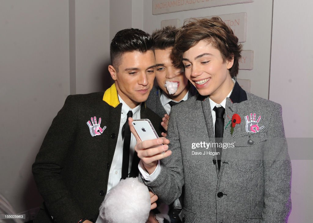 X Factor finalists Jamie Hamblett, Josh Cuthbert and George Shelley of Union J pose at the Cosmopolitan Ultimate Woman of the Year Awards after party at Victoria & Albert Museum on October 30, 2012 in London, England.