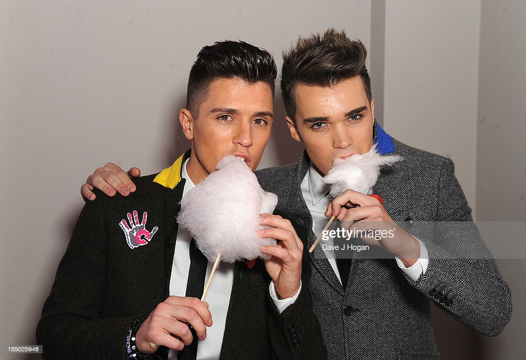 X Factor finalists Jamie Hamblett, Josh Cuthbert of Union J pose at the Cosmopolitan Ultimate Woman of the Year Awards after party at Victoria & Albert Museum on October 30, 2012 in London, England.