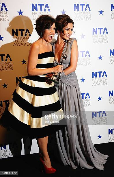 X Factor judges Danni Minogue and Cheryl Cole appear with their award for Most Popular Talent Show at the National Television Awards held at O2 Arena...