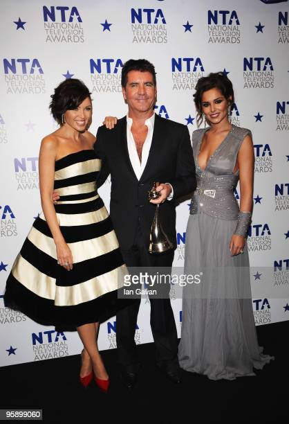 X Factor judges Danni Minogue Simon Cowell and Cheryl Cole appear with their award for Most Popular Talent Show at the National Television Awards...