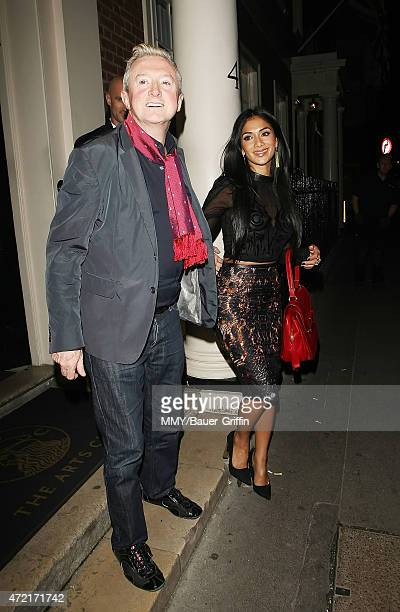 Factor Judges Louis Walsh and Nicole Scherzinger are seen leaving the Arts Club on October 09, 2012 in London, United Kingdom.