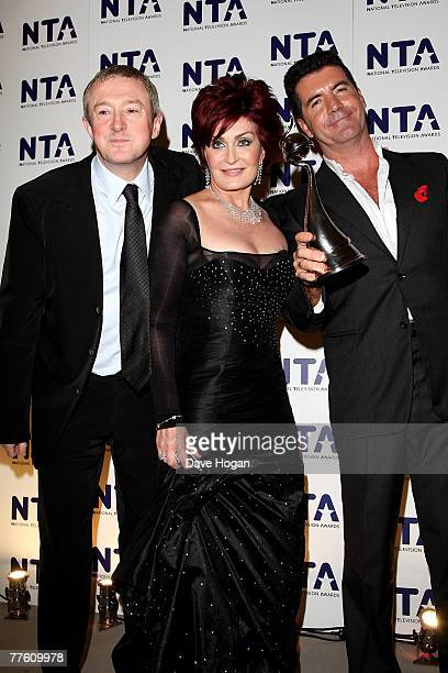 'X Factor' judges Luis Walsh Sharon Osbourne and Simon Cowell pose with the award for Most Popular Talent Show at the National Television Awards 2007...