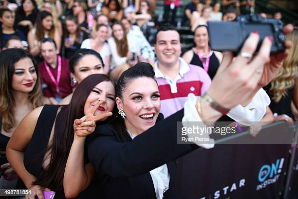Factor runner up Louise Adams takes a selfie with fans on the red carpet ahead of the 29th Annual ARIA Awards 2015 at The Star on November 26, 2015...