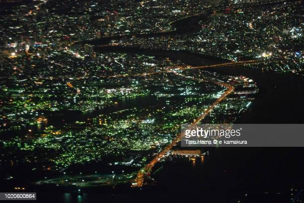 Factories' illumination in Kawasaki city in Kanagawa prefecture in Japan night time aerial view from airplane