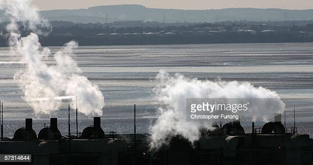 Factories on the Wirral peninsular emit vapour on April 11 Cheshire England The world's population is more environmentally aware now than ever with...
