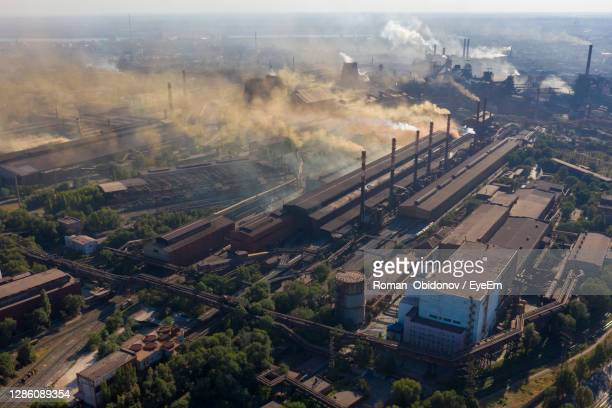 factories smoke toxic substances into the atmosphere - greenpeace stock pictures, royalty-free photos & images