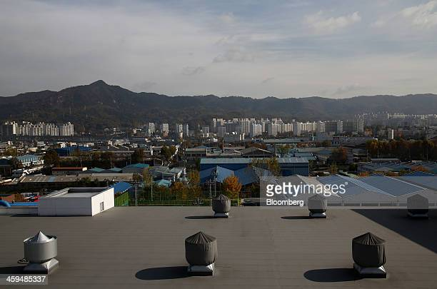 Factories stand at the Daejeon Industrial Complex next to residential buildings in the background in Daejeon South Korea on Friday Nov 8 2013...
