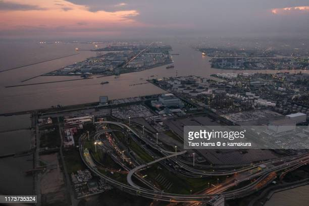 factory area in kanagawa prefecture of japan sunset time aerial view from airplane - 川崎市 ストックフォトと画像