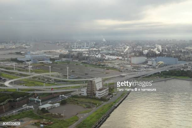 Factory area in Kawasaki city and junction of Tokyo Bay Aqua Line and Shuto Expressway daytime aerial view from airplane