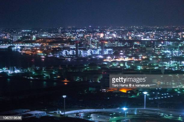 Factory area in Kawasaki city in Kanagawa prefecture in Japan night time aerial view from airplane