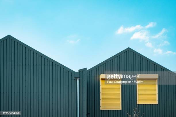 factory building against blue sky - architecture stock pictures, royalty-free photos & images