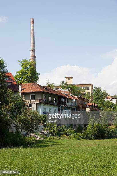 factory chimney and flats near Kokra river Kranj Slovenia