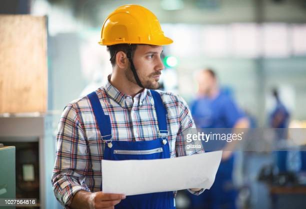 factory employee contemplating. - incidental people stock pictures, royalty-free photos & images
