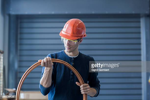 factory engineer inspecting power cable - sigrid gombert stock pictures, royalty-free photos & images