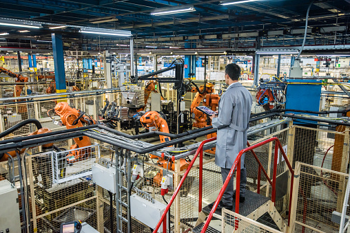 Factory engineer inspecting the work process 916478814