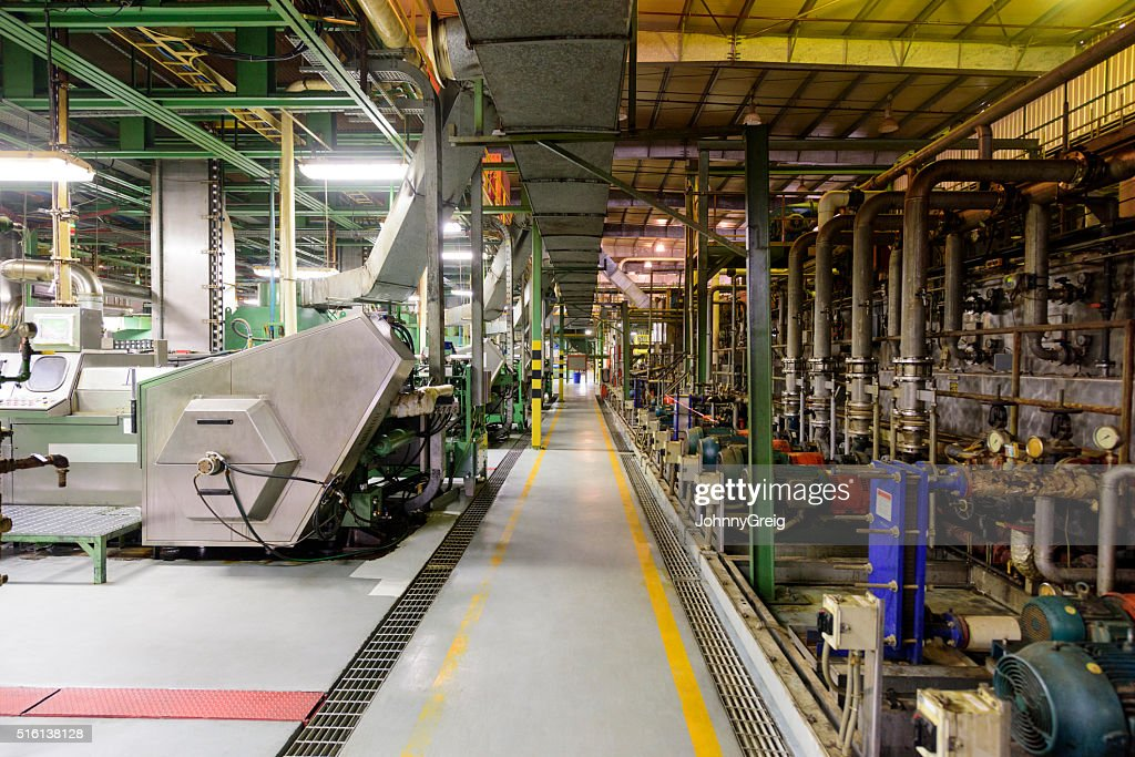 Factory floor and machinery in aluminium processing plant : Stock Photo