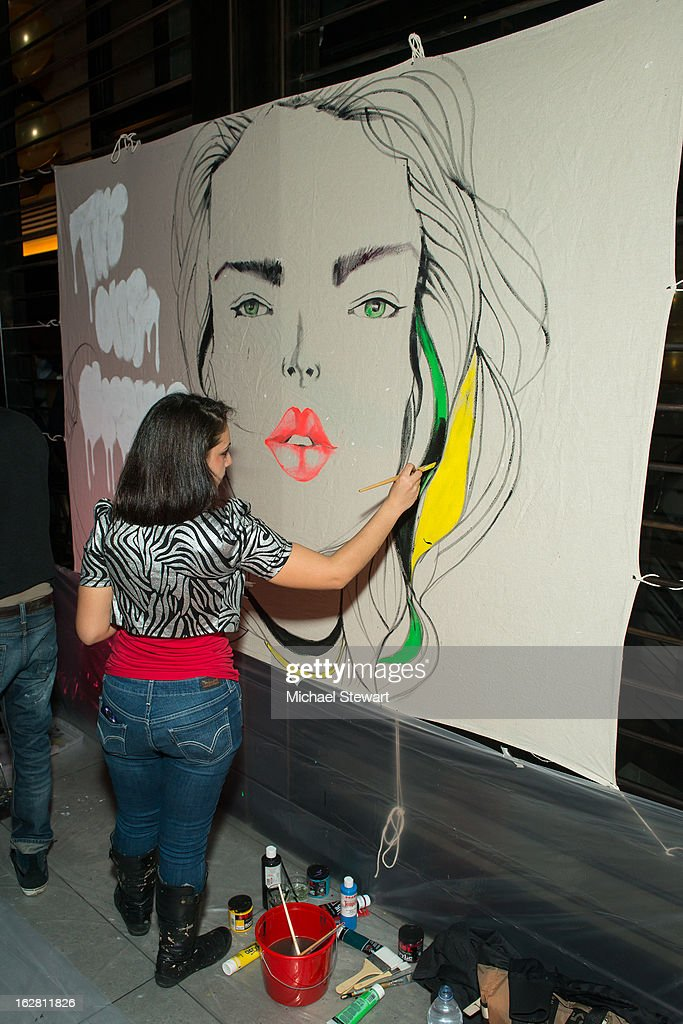 A Factory Fresh artist paints during The ONE Group's Ristorante Asellina celebrates two years on Park Avenue South NYC at Ristorante Asselina on February 27, 2013 in New York City.