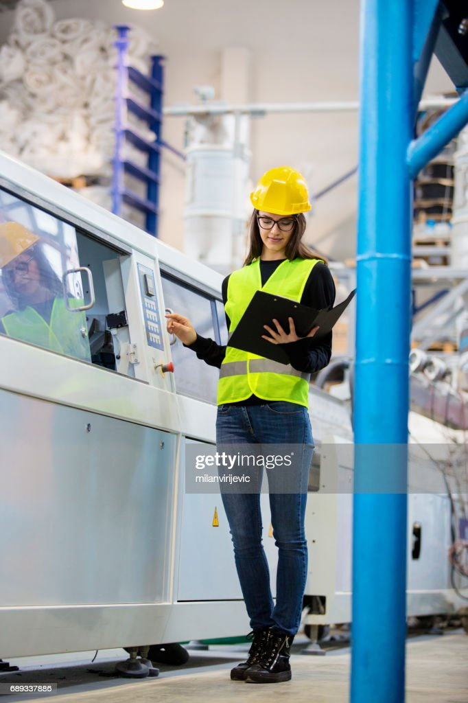 Factory inspection woman reading from notes : Stock Photo