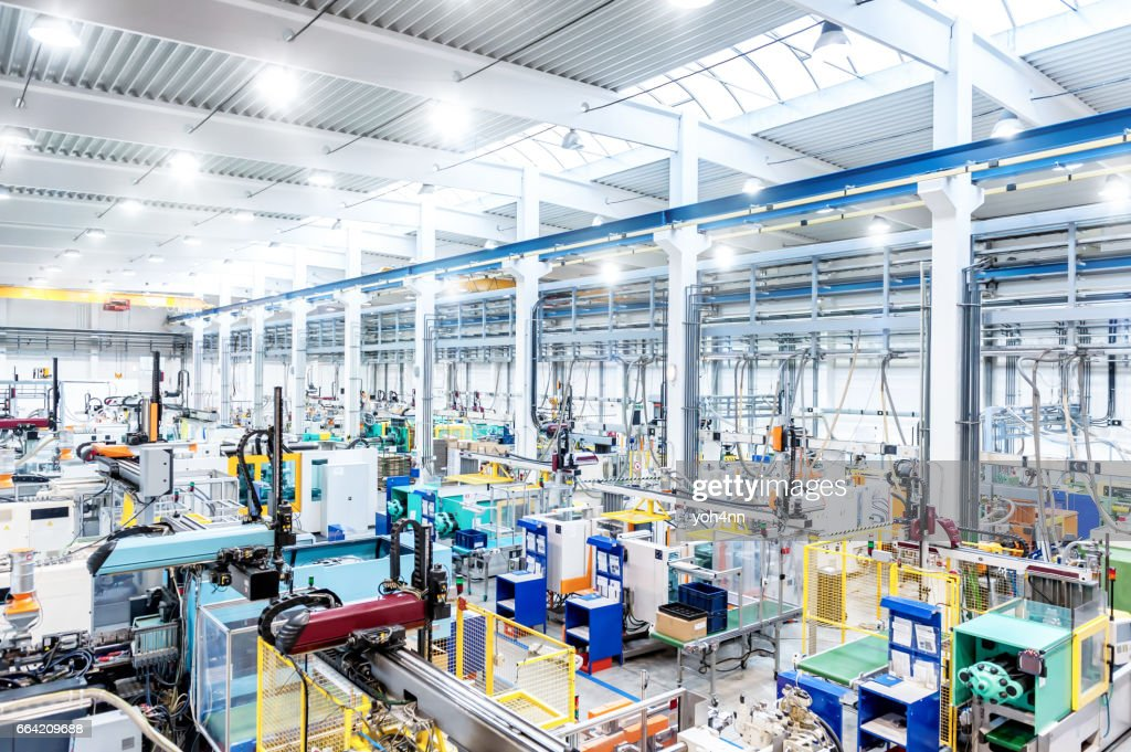 Factory interior & futuristic machines : Stock Photo