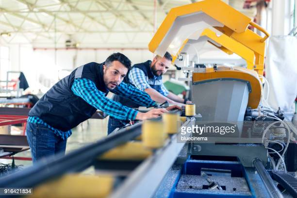 factory interiors for manufacturing pvc windows and doors - production line stock pictures, royalty-free photos & images