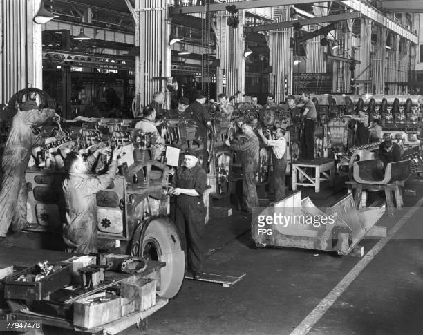 Factory labourers hard at work circa 1940