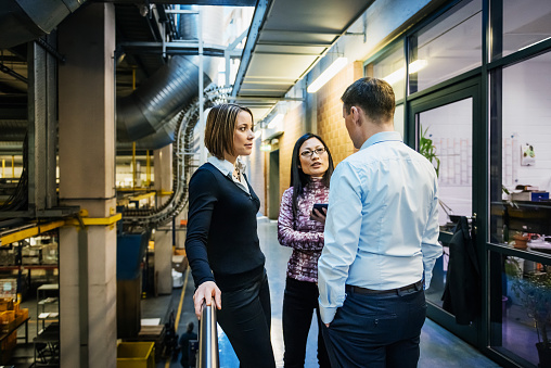 Factory Management Discussing on Hallway - gettyimageskorea