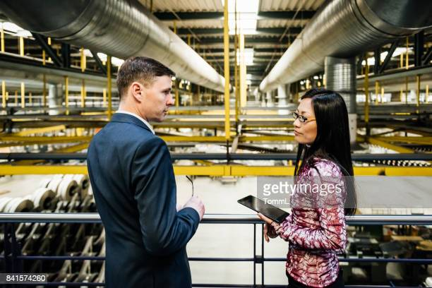 Factory management discussing