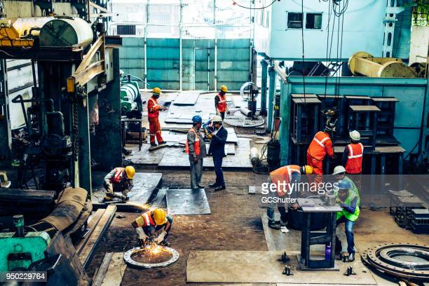 factory operations in full work. - industry stock pictures, royalty-free photos & images