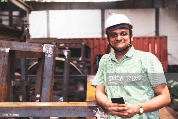 Factory owner smiling at the camera