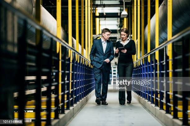 factory owner talking with operations manager - decisions stock pictures, royalty-free photos & images