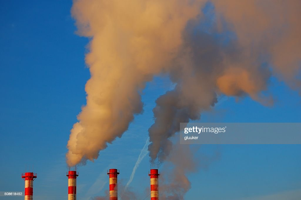 factory pipes smoke in the blue sky : Stock Photo