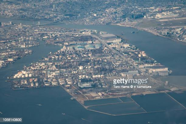 factory reclaimed land in kawasaki city in kanagawa prefecture in japan daytime aerial view from airplane - 川崎市 ストックフォトと画像