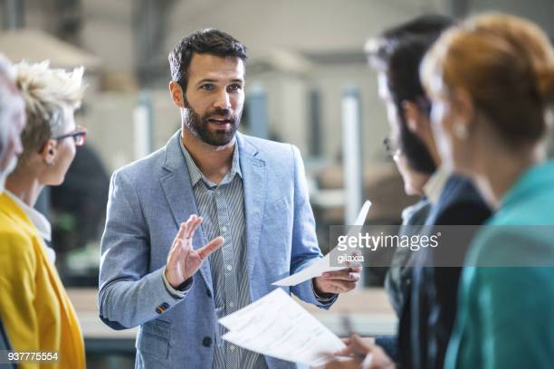 factory staff meeting. - leadership stock pictures, royalty-free photos & images