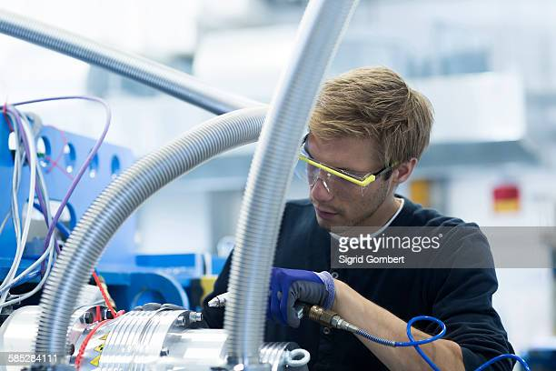 factory technician testing network cables - sigrid gombert stock pictures, royalty-free photos & images