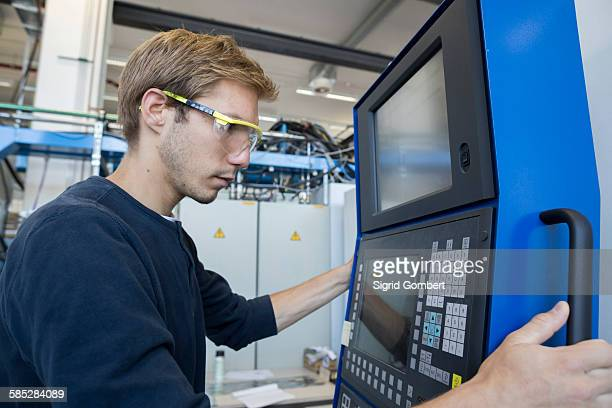 factory technician working on control panel - sigrid gombert stock-fotos und bilder