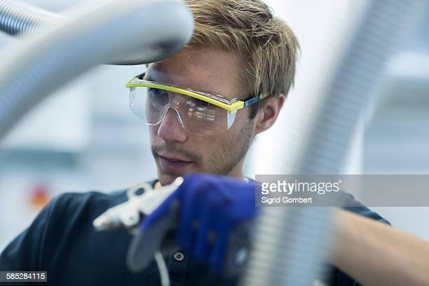 Factory technician working on network cables