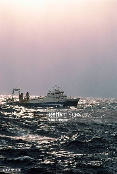 factory trawler on stormy bering sea, alaska, usa - bering sea stock pictures, royalty-free photos & images