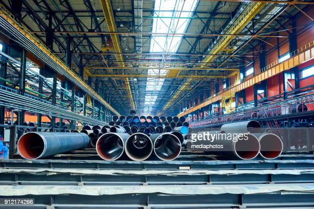 Factory warehouse with manufactured tubes