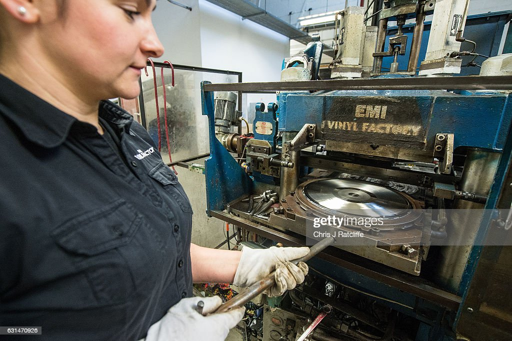Factory worker Aga Dolega-Lawry places a new master record into a pressing machine to make copies of 'Definitely Maybe' by Oasis at The Vinyl Factory on January 11, 2017 in Hayes, England. The Vinyl Factory is the largest vinyl pressing plant in the United Kingdom and produces up to 1.4 million records a year. The factory was founded in 2001 and has seen a 20% increase in sales and production year on year with clients including Warner Music, Universal Music, Bjork's label and their own label. Sales of vinyl records reached a 25 year high in 2016 when more than 3.2 million LPs were sold, a rise of 53% on the previous year.