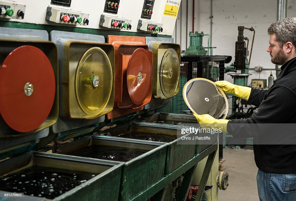 Factory worker Arek Grzeda places a master copy of a vinyl record in place ready to be submerged into nickel plating solution before being ready to press records at The Vinyl Factory on January 11, 2017 in Hayes, England. The Vinyl Factory is the largest vinyl pressing plant in the United Kingdom and produces up to 1.4 million records a year. The factory was founded in 2001 and has seen a 20% increase in sales and production year on year with clients including Warner Music, Universal Music, Bjork's label and their own label. Sales of vinyl records reached a 25 year high in 2016 when more than 3.2 million LPs were sold, a rise of 53% on the previous year.