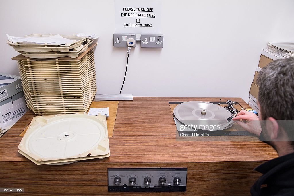 Factory worker Arek Grzeda plays a master copy of a vinyl record in a testing room to ensure its quality before being copied and going to press at The Vinyl Factory on January 11, 2017 in Hayes, England. The Vinyl Factory is the largest vinyl pressing plant in the United Kingdom and produces up to 1.4 million records a year. The factory was founded in 2001 and has seen a 20% increase in sales and production year on year with clients including Warner Music, Universal Music, Bjork's label and their own label. Sales of vinyl records reached a 25 year high in 2016 when more than 3.2 million LPs were sold, a rise of 53% on the previous year.